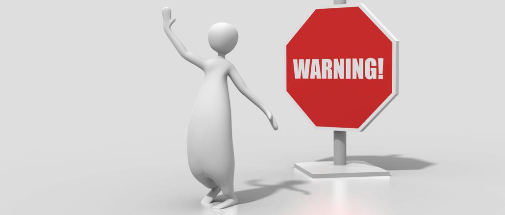 """ein Männchen vor einem Schild mit """"Warnung"""""""